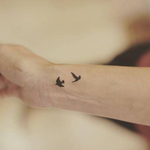 Two little birds on the wrist. Tattoo artist: Lu Reis