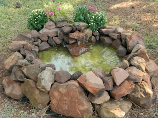 A kiddie pool some rocks and a small pump perfect for Garden pond do you need a pump