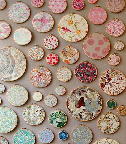 I am really loving this Liberty of London. Remember when they had a line at Target? I am getting ready to make this same type of display in Molly's room with shabby chic style fabric. I've been collecting hoops for a while.