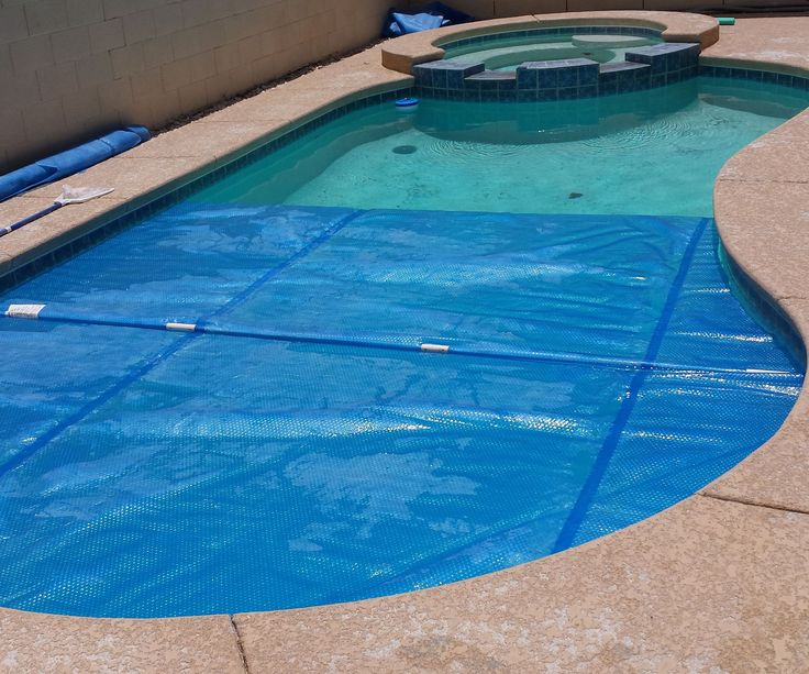 """A solar blanket is a giant """"bubble-wrap"""" cover that floats on the top of the water in your swimming pool. It provides a number of benefits: Heats the water with the sun - so its more comfortable and it extends the swimming season Reduces evaporation which saves on water refilling Blocks some of the UV light that destroys the chlorine in the water so you don't have to add as many pool chemicals. Helps keep the heat in at night when the temperature drops, especially important in deser..."""