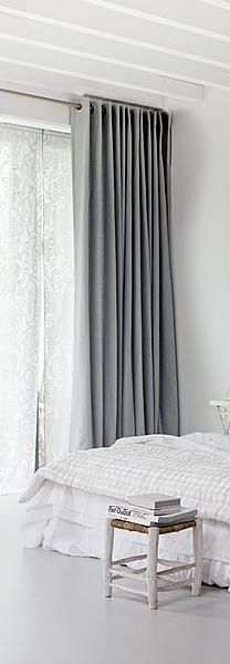 floor to ceiling eyelet curtains (drapes) in soft blue grey with an inner layering of sheer white flat panel curtains