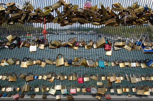 Love locks on the Passerelle Léopold-Sédar-Senghor in Paris.