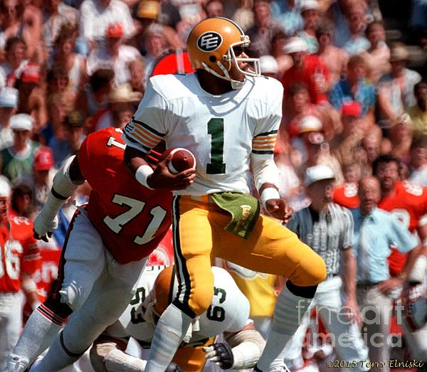 Action photograph of Edmonton Eskimos QB Warren Moon #1 playing against the B.C. Lions at Empire Stadium in Vancouver, 1982.PHOTOGRAPH BY TERRY ELNISKI