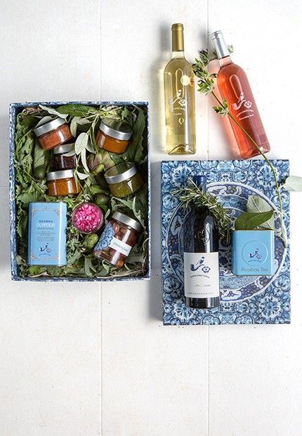 Holiday Party Hamper - Show your gratitude to a generous host, colleague or loved one this Christmas with our Holiday Hamper. The content of the iconic blue Delft box is sure to spread the yuletide cheer. It includes three wines from our cellar, the best quality extra virgin olive oil from our olive press, organic rooibos tea and seasonal preserves from our orchards| Babylonstoren Frasnchhoek