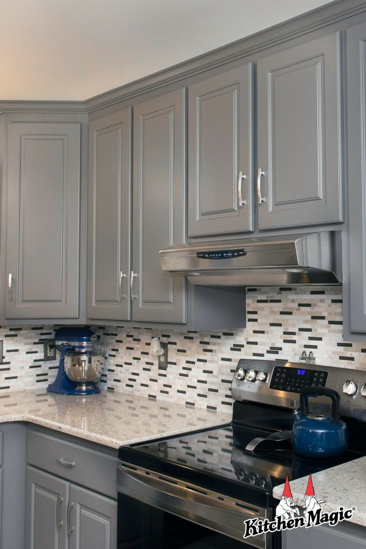 The Salt Pepper Look Of This Tile Backsplash Brings Fantastic Visual Appeal To This Contemporary Suede Gray Kitchen Custom Kitchen Tile Kitchen Tile Kitchen