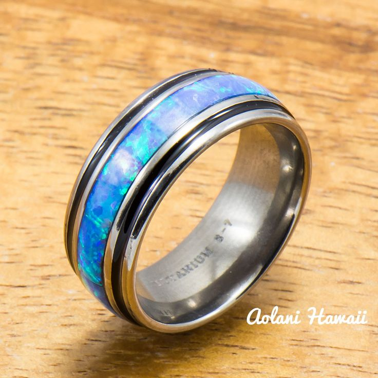 Crafted with highly scratch-resistant(3 times harder than steel) titanium. This ring features resin sealed and water proof Opal inlay in the center and polished finish metal surface. Flat Style for co