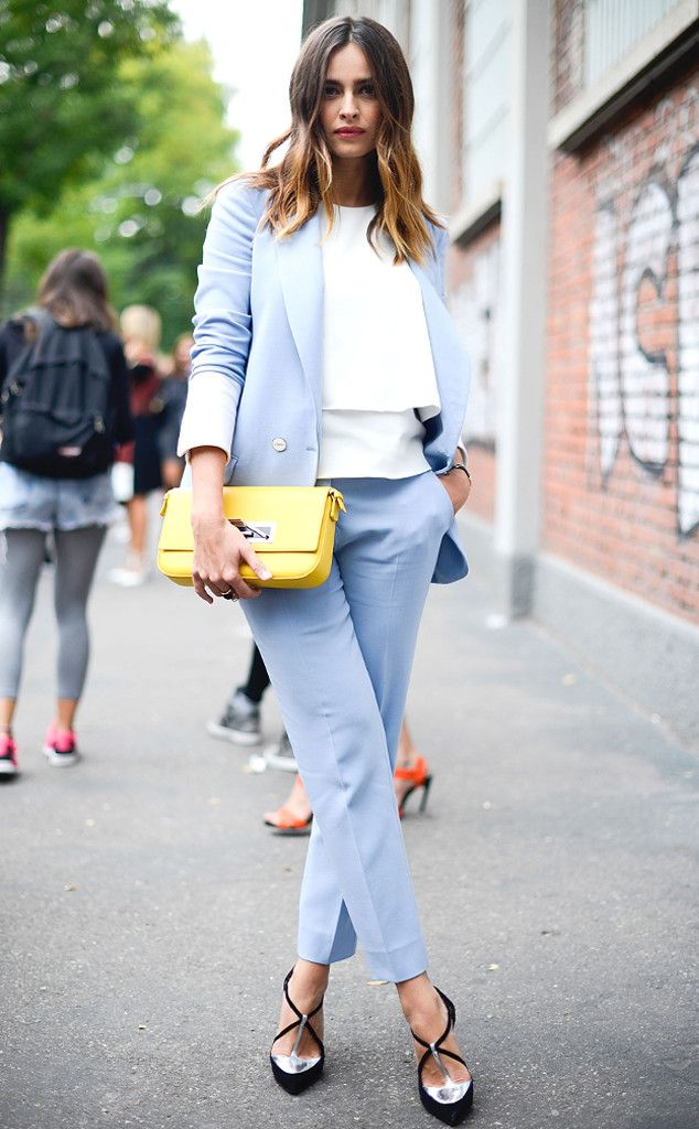 Keep in monochromatic and incorporate a bold  bag. Kasia Smutniak street style Milan Fashion Week Spring 2015.