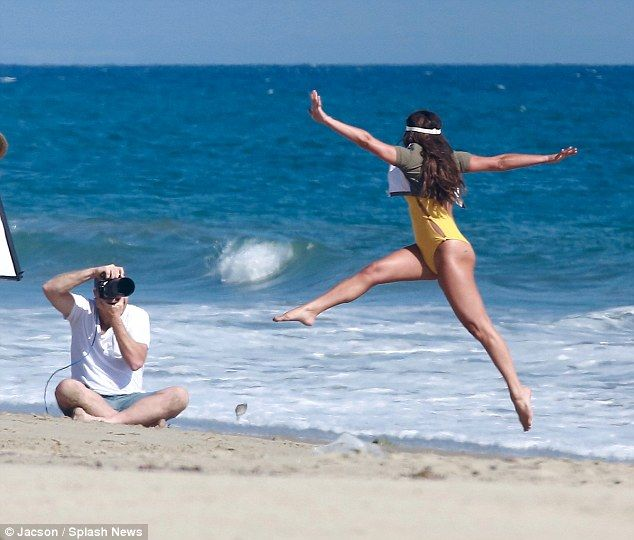 Full of Glee! Later she showed off her skills, and her long legs, when she jumped on cue for an action shot on the sand