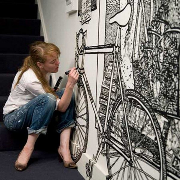 "Charlotte Mann is a talented British artist who became famous due to her fascinating wall drawings and drawn room installations. Her work includes drawings of ""rooms in room"", created with a black marker on a white background."