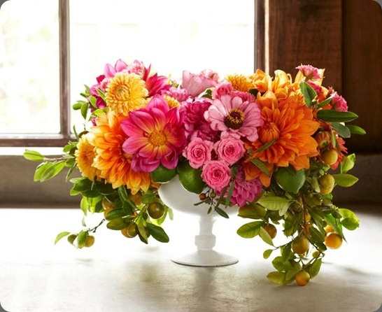 Vibrant cascading flower arrangement  in compote by max gill floral and sean dagen photo #footedbowl  #orangepink #flowers