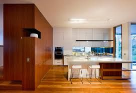 black kitchen with timber wall - Google Search