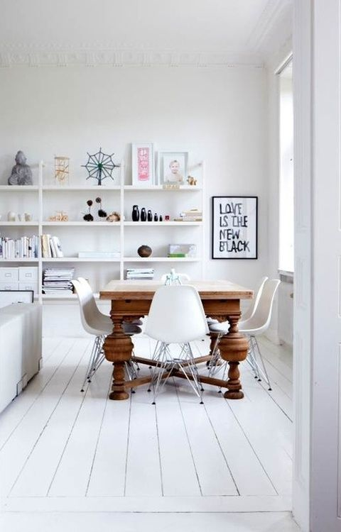 Use accessories to add a pop of color into your all white decor like this transitional dining room/living room concept.