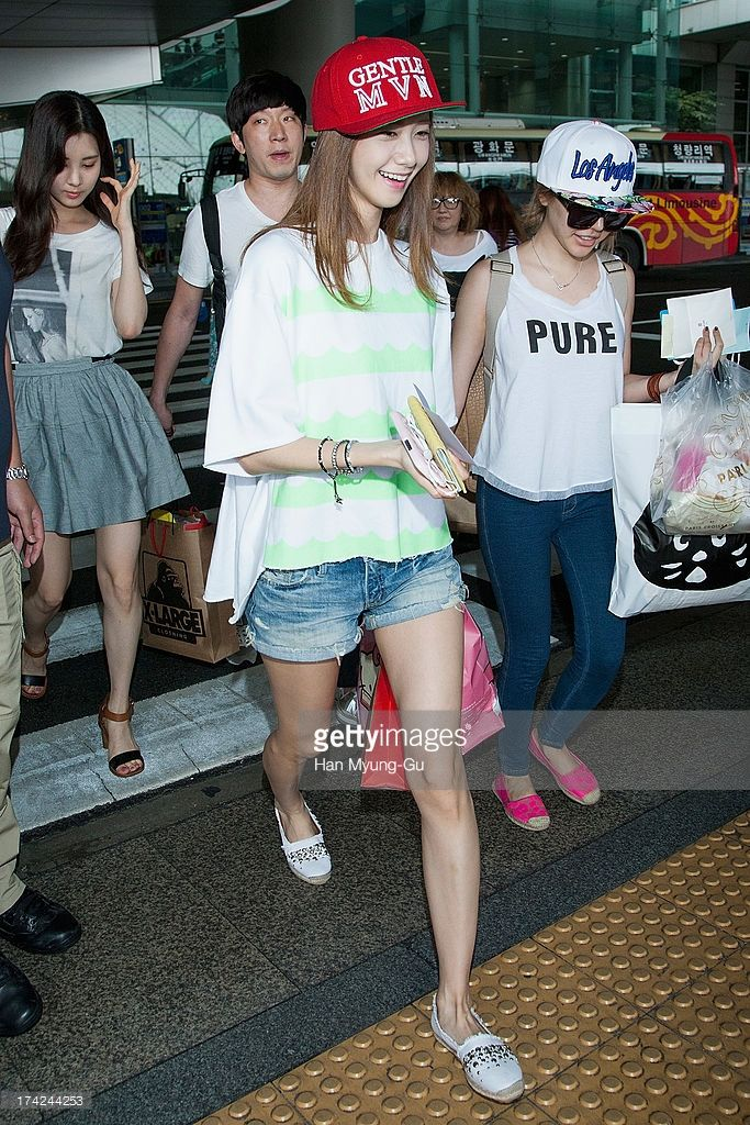 Yoona and Sunny of South Korean girl group Girls' Generation are seen upon arrival at Incheon International Airport on July 22, 2013 in Incheon, South Korea.