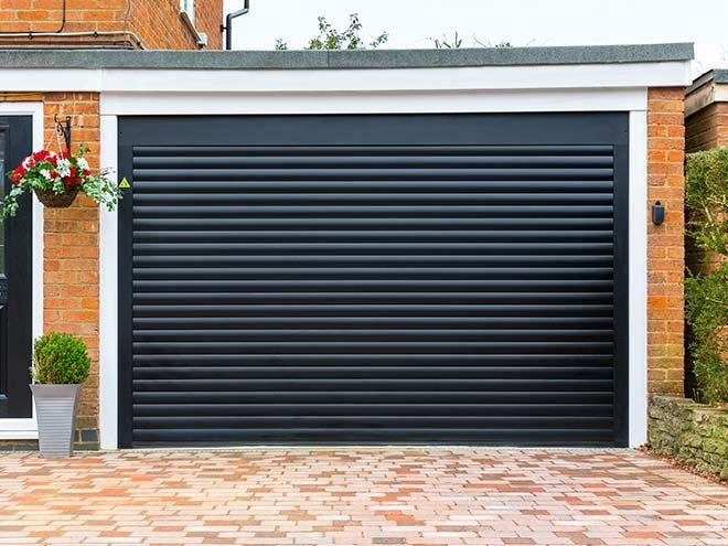 Automatic roller garage doors everest black windows for 11 x 7 garage door
