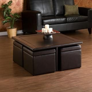 @Overstock - Sleek and functional, the faux-leather coffee table with storage ottomans not only looks great but also will provide your living room some extra out-of-sight storage. Sturdy construction and rich, brown, faux-leather upholstery make this set a favorite.http://www.overstock.com/Home-Garden/Crestfield-Dark-Brown-Coffee-Table-Storage-Ottoman-Set/5283486/product.html?CID=214117 $384.99