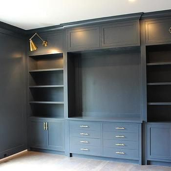 Gray Home Office with Gray Built Ins and Brass Swing Arm Sconces