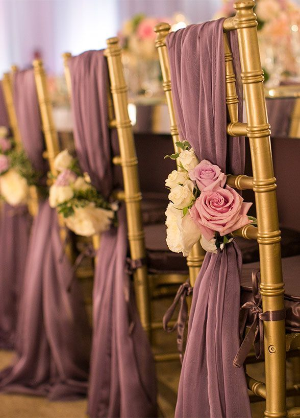 Fabulous florals are the perfect addition to purple chair sashes. wedding chair decoration