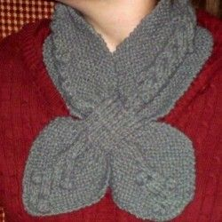 Looking for a scarf to keep your neck warm?  Use this free knitting pattern to keep the cold out!  The warm gray color will look good against any coat.
