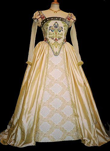 """A reproduction costume. """"The corseted elizabethan-shaped bodice was constructed in an elaborate brocade, embellished with further beading and faux fur. The main skirt was in a deep cream silk, opening at the front to show a brocade panel, enhanced with pearls."""""""