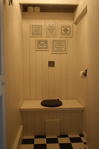 I love this toilet design - perfect for 'hiding' a modern toilet to fit in with a prim house