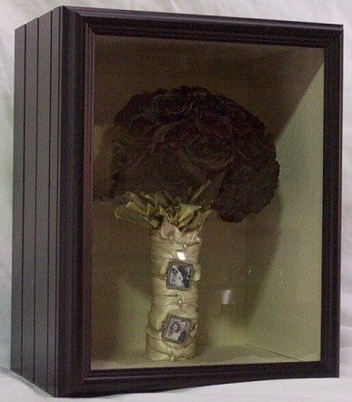 Wedding flowers in a shadow box. Great idea!