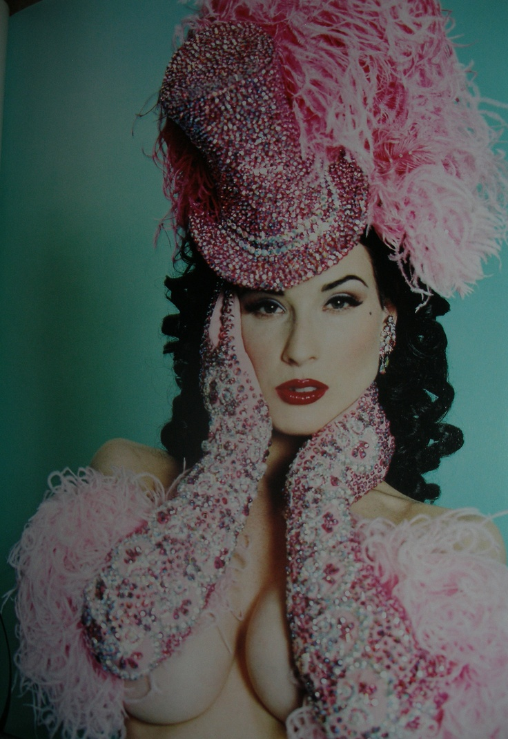 The great Dita Von Teese in the custom-made pink Swarovski crystal costume for one of her celebrated burlesque routines.