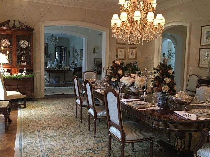 Huge dining table, federal style cabinet, large chandelier, beautiful patterned neutrals
