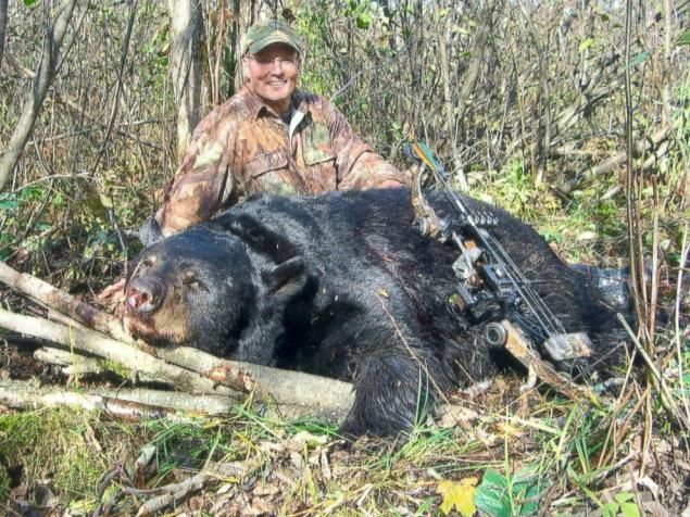 Walter Palmer poses with a black bear he shot and killed during a November 2006 hunt in Wisconsin. - Wisconsin Dept.Of Natural Resources (illegally)