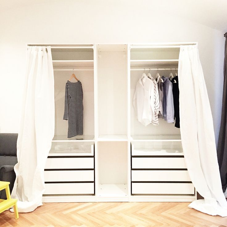 Empty IKEA Pax open closet organisation