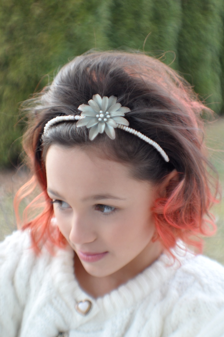 Handmade headband with classic style for any occasion.