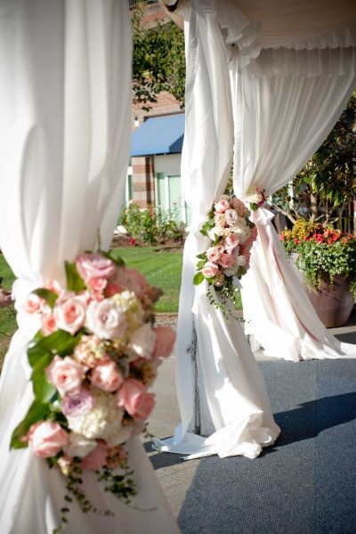Beautiful flower detailing on the tent's drapes.