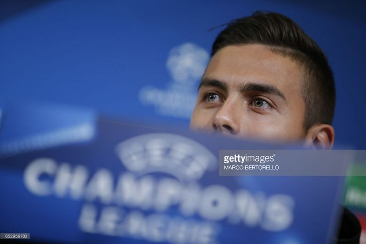 Juventus' forward from Argentina Paulo Dybala attends a press conference on the eve of the UEFA Champions League football match Juventus Vs FC Porto on March 13, 2017 at the 'Juventus Stadium' in Turin. / AFP PHOTO / Marco BERTORELLO