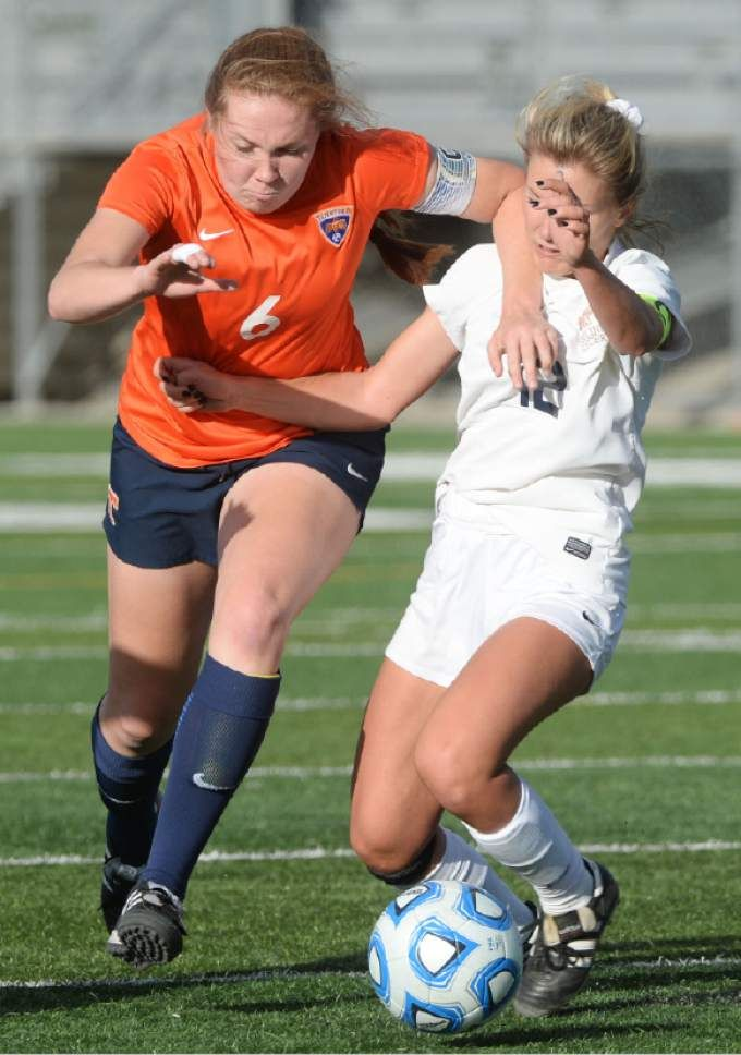 (Steve Griffin / The Salt Lake Tribune)  Timpview's Abby Woodfield, left,  powers past Skyline's Natalie Winward during 4A semifinal soccer match between at Juan Diego Catholic High School in Draper Tuesday October 18, 2016.