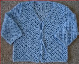 Knitting pattern for a ladies lace cardigan with 3/4 sleeves, in plus sizes.
