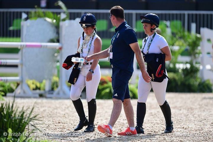 Kitty King and Gemma Tattersall walking the eventing showjumping course
