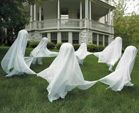I saw this idea years ago, so I did it for our yard. I have one ghost for every person in my family (there are 7 of us) and I even went so far as to have my husband cut each one to the exact height of each family member. So much fun!