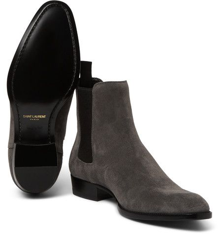 Saint Laurent's Chelsea boots will make a solid addition to your footwear collection. They've been crafted in Italy from the finest grey suede - a considered alternative to black or brown. Generous elasticated side inserts ensure a comfortable fit and make them easy to pull on and off. Channel the brand's rock 'n' roll sensibility and wear them with skinny jeans and a leather biker jacket.