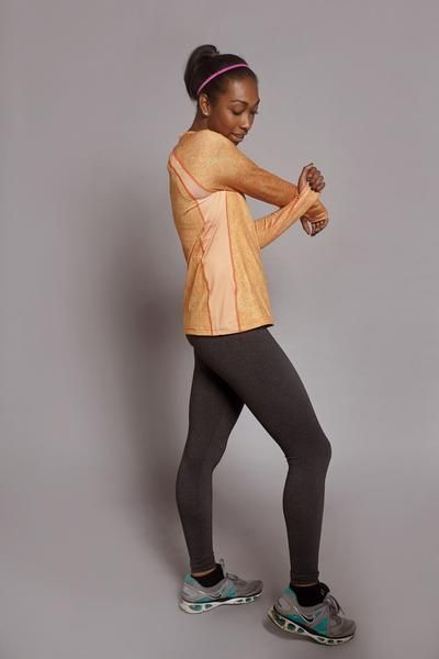 SparkFire Girl's High Performance Activewear in FIERCE Spark (Orange) - Designed in USA - Sustainable REPREVE® fabric, made in the USA from 100% recycled PET fibers with spandex blend - Available for Pre-Order - SparkFireActive.com