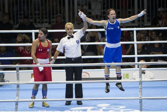 Canadian Mandy Bujold jumps for joy after the split decision went in her favour after defeating Marlen Esparza in the gold medal Pan Am women's fly match.