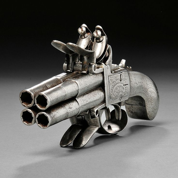 Continental Four-barrel Flintlock Pistol, c. late 18th century, iron butt and frame engraved with foliate designs, four rifled barrels, two hammers, and four steels.