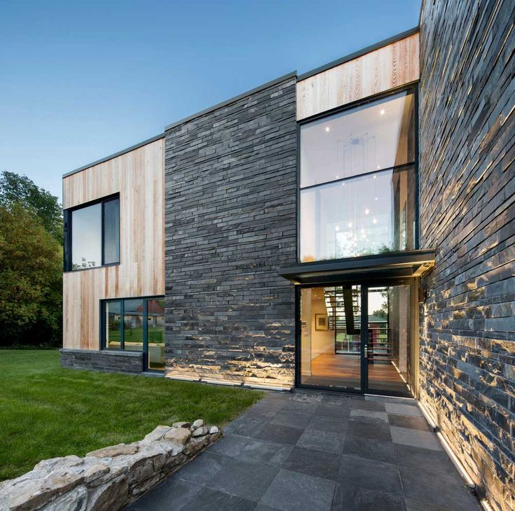 Contemporary Farmhouse Design Mixes Wood Stone And Glass