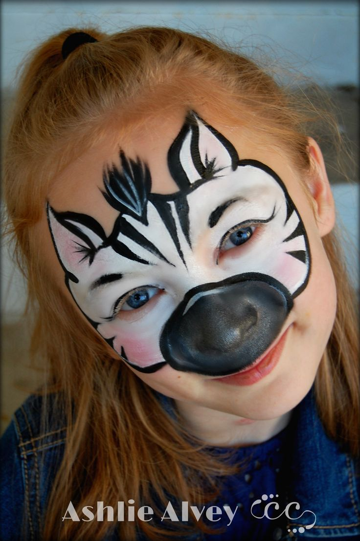 Zebra face paint design painted by Ashlie Alvey of Chubby Cheeks Body Art in Savannah. Georgia. #chubbycheeksart #savannah #georgia #facepaint #facepainter