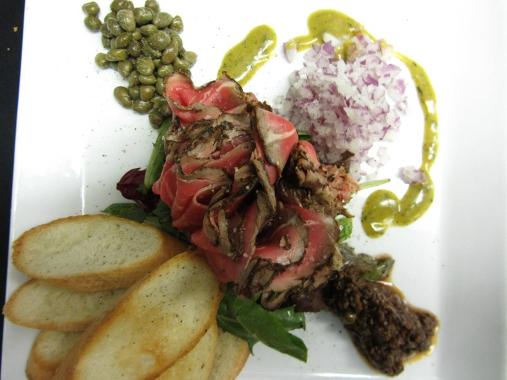 Beef Carpacciao — at The Cattlemen's Club Restaurant. (250) 542 - 2178.