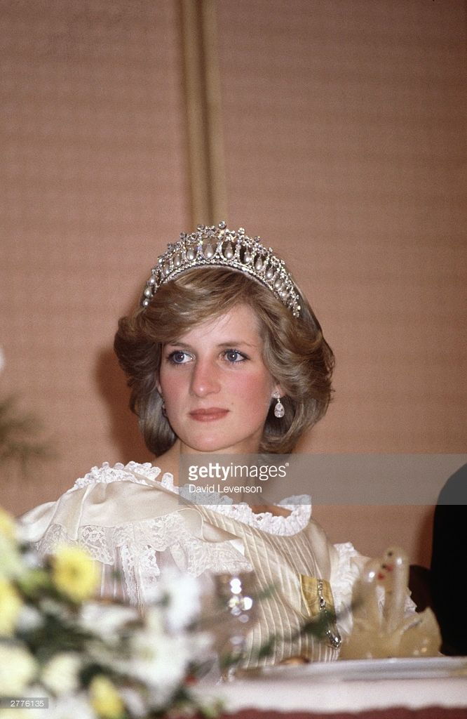 Diana Princess of Wales at the farewell State Banquet on April 29,1983 in Auckland, New Zealand at the end of the Royal tour of New Zealand. Diana wore a gown designed by Gina Fratini, the Queen Mary tiara, and the Queen's Family Order decoration.