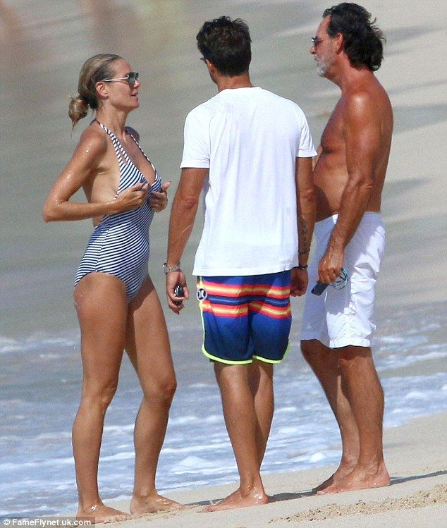 Fun in the sun! On Wednesday Heidi Klum continued to enjoy her sunsoaked Caribbean holiday, as she ran into actor David Charvet on the beach