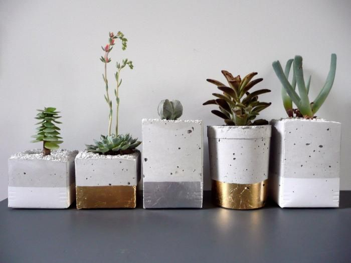 "Spotted via Feliz, a collection of cement planters wrapped in metal leaf from Austin, TX-based designer Joanna Wojtkowiak. To us, they scream ""holiday season."""