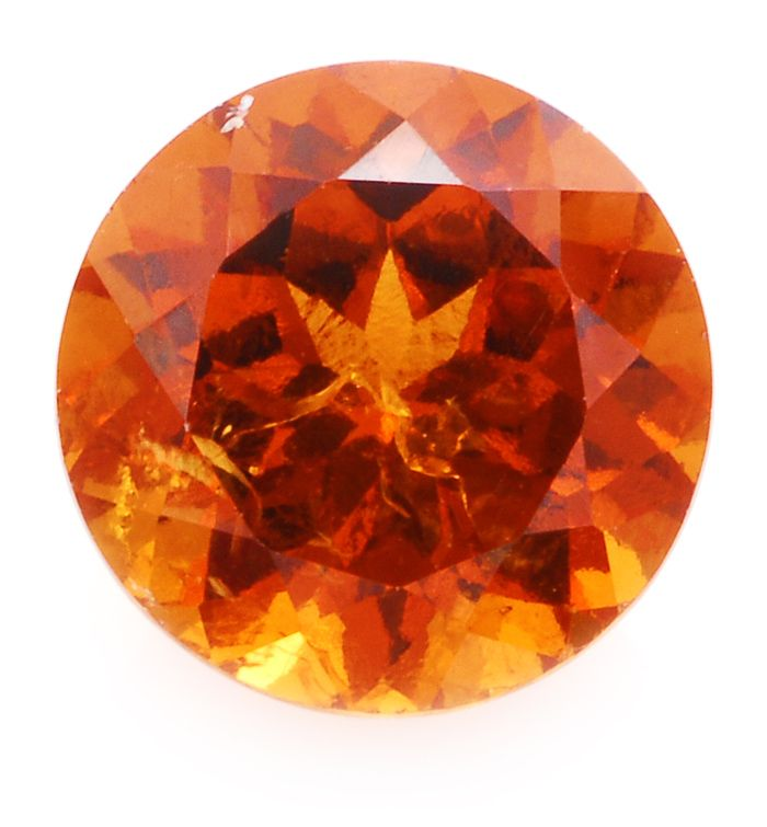 Hessonite, also known as cinnamon stone or cinnamon garnet, is the most common variety of grossularite. The name comes from the Greek hesson, meaning inferior which is an allusion to the lower hardness and density compared to most other garnet species.
