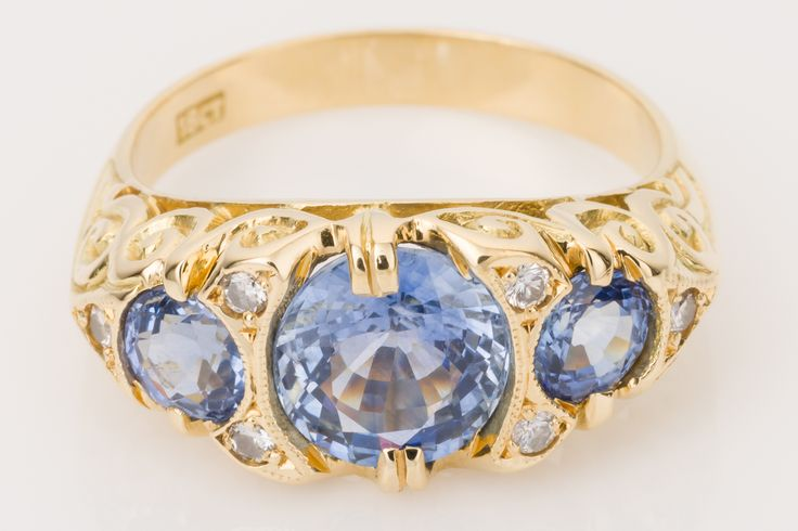 Beautiful Ceylon sapphires, medium lilac/blue set with a hint of sparkling diamonds in 18k yellow gold. Available on www.1stdibs.com