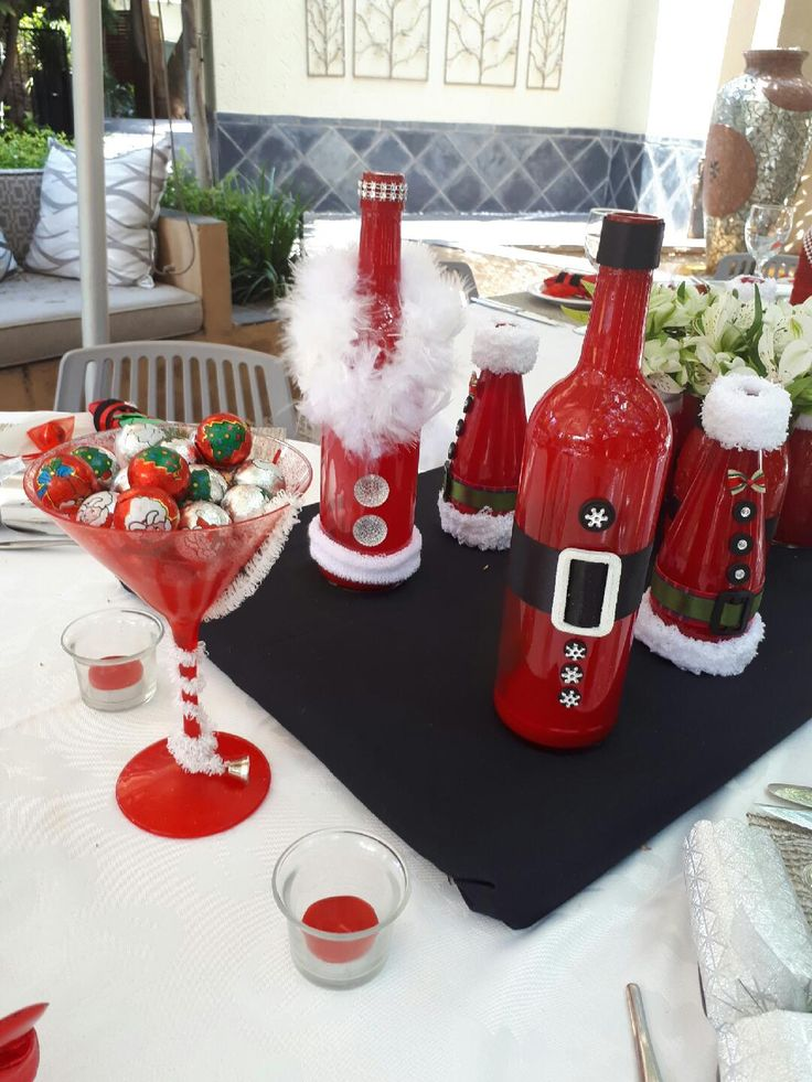 DIY Festive glass bottles and jars - decorated for your Christmas table