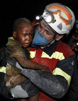 This is the a picture captured of a fire fighter finding a baby boy in the rubble during the after math of the tragic Haiti Earthquake.  Haiti Earthquake
